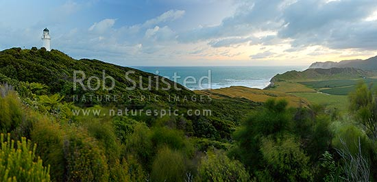 East Cape and lighthouse at sunset, Tunanui Stream and Waikori Bluff distant right. Panorama, East Cape, Gisborne District, Gisborne Region, New Zealand (NZ) stock photo.