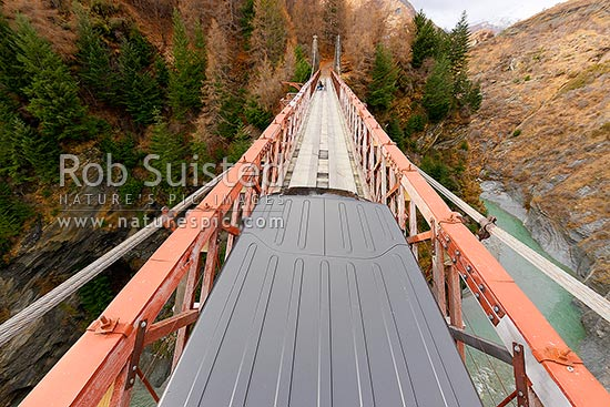Crossing the Historic Skippers Bridge over the Shotover River gorge (96 m long, 90 m high, the 1901 Skippers suspension bridge), Queenstown, Queenstown Lakes District, Otago Region, New Zealand (NZ) stock photo.