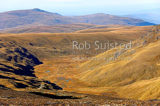 The Old Man Range / Kopuwai Scenic Reserve and the head of Campbell Creek with oxbow lakes, Alexandra, Central Otago District, Otago Region, New Zealand (NZ) stock photo.