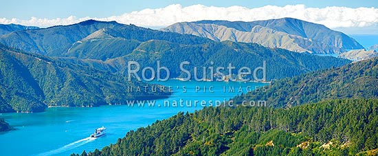 Tory Channel with the Interislander ferry Kaitiaki heading for Cook Strait. Arapawa Island left. Panorama, Marlborough Sounds, Marlborough District, Marlborough Region, New Zealand (NZ) stock photo.