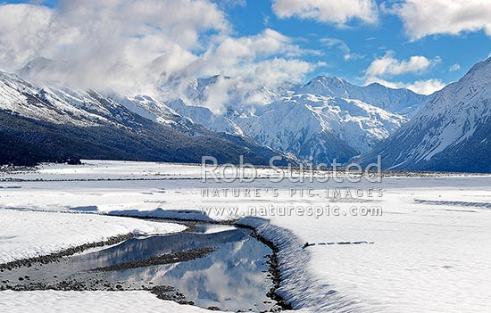 Waimakariri River valley headwaters in heavy winter snow, Arthur's Pass National Park, Selwyn District, Canterbury Region, New Zealand (NZ) stock photo.