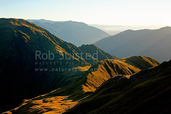 Thomas Range high above the Haast River Valley, with Jackson Bay distant, Haast, Westland District, West Coast Region, New Zealand (NZ) stock photo.