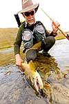 Fly fisherman with a trout