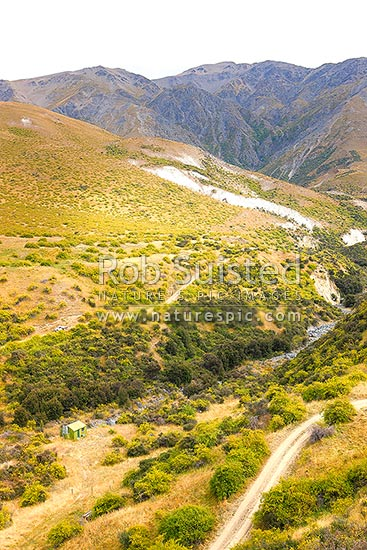 Bluff Stream Hut in limestone country on Muzzle Station. Constitution Hill (1974m) above, Muzzle Station, Kaikoura District, Canterbury Region, New Zealand (NZ) stock photo.