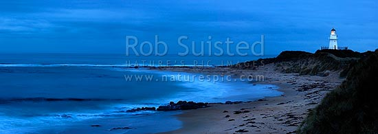 Waipapa Point lighthouse and beach panorama on a moody evening, Fortrose, Southland District, Southland Region, New Zealand (NZ) stock photo.