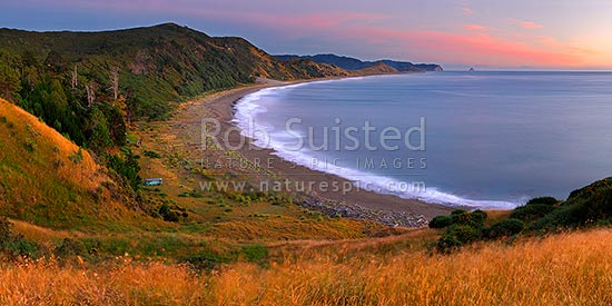 Port Awanui and Te Wharau Beach pre dawn sunrise. East Cape and East Island (Whangaokeno) visible in distance. Panorama, Port Awanui, East Coast, Gisborne District, Gisborne Region, New Zealand (NZ) stock photo.