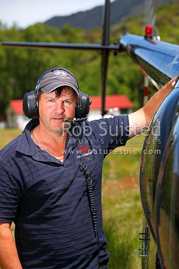 Phil Packham, helicopter pilot, at Bush Gully on Molesworth Station. Portrait, Molesworth Station, New Zealand (NZ) stock photo.