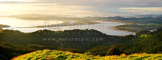 Omaha Beach and Whangateau Harbour at dawn, with Ti Point and Kawau Island far left. Point Wells far right. Panorama, Leigh, Rodney District, Auckland Region, New Zealand (NZ) stock photo.