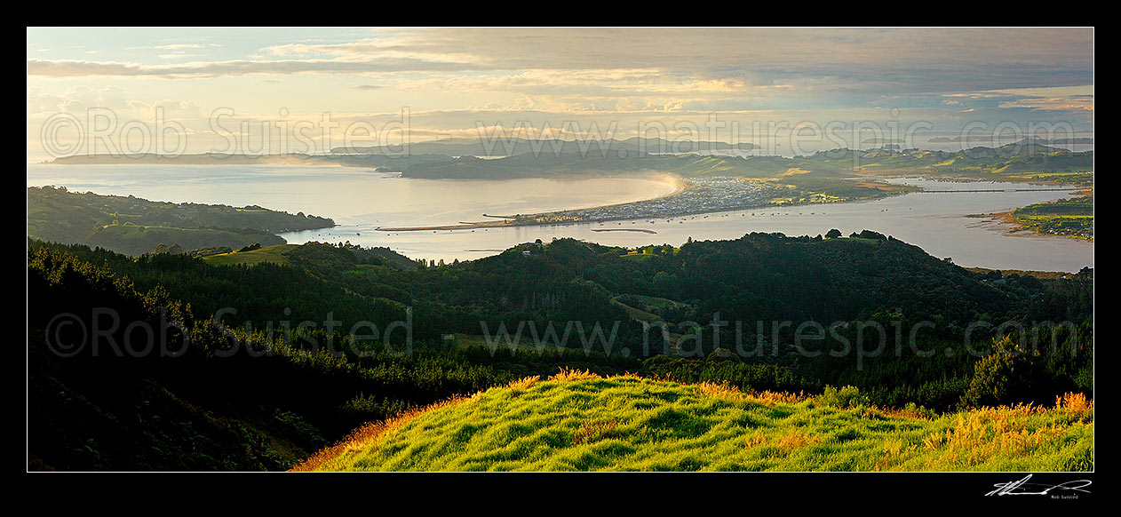 Image of Omaha Beach and Bay. Tawharanui Peninsula and Ti Point left, Whangateau Harbour right, and Kawau Island beyond, at dawn. Panorama, Leigh, Rodney District, Auckland Region, New Zealand (NZ) stock photo image