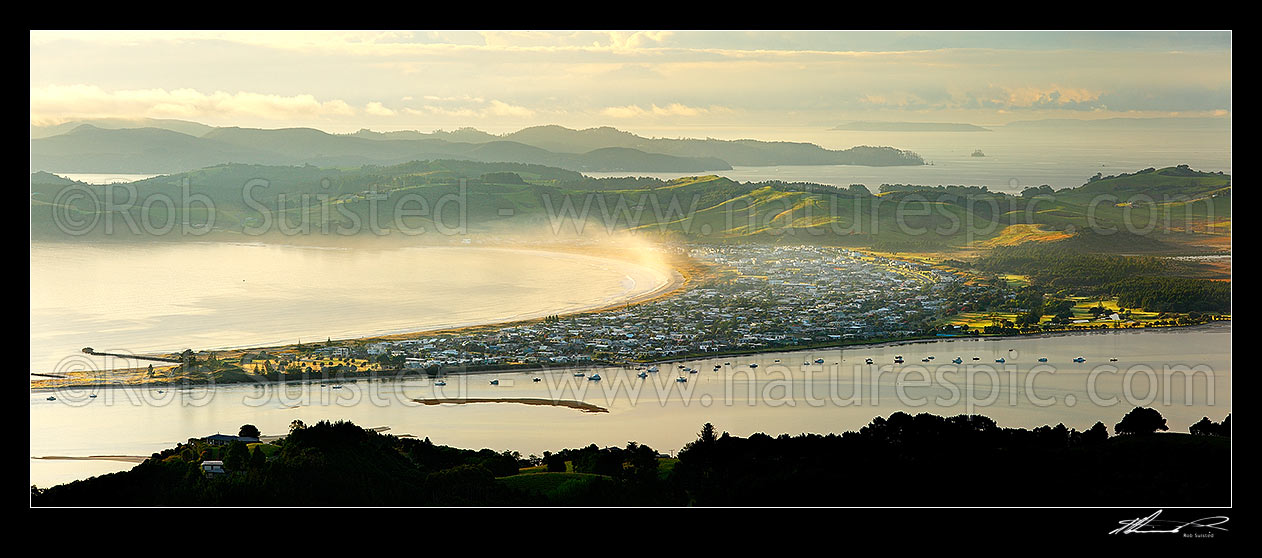 Image of Omaha Beach, Little Omaha Bay and Whangateau Harbour at dawn. Kawau Island beyond. Panorama, Leigh, Rodney District, Auckland Region, New Zealand (NZ) stock photo image
