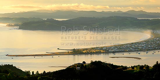 Omaha Beach and Bay. Whangateau Harbour entrance with Tawharanui Peninsula and Kawau Island beyond, at dawn, Leigh, Rodney District, Auckland Region, New Zealand (NZ) stock photo.