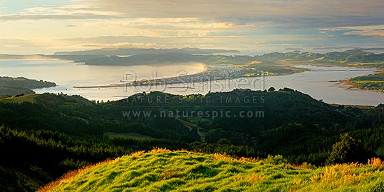 Omaha Beach and Bay. Tawharanui Peninsula and Ti Point left, Whangateau Harbour right, and Kawau Island beyond, at dawn. Panorama, Leigh, Rodney District, Auckland Region, New Zealand (NZ) stock photo.