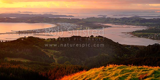 Whangateau Harbour and Omaha Beach. Hauraki Gulf and Kawau Island beyond. Dawn. Panorama, Leigh, Rodney District, Auckland Region, New Zealand (NZ) stock photo.