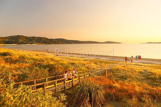Petone Beach sunset with Eastbourne coast and Wellington Harbour entrance beyond, Petone, Hutt City District, Wellington Region, New Zealand (NZ) stock photo.
