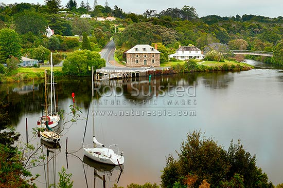 Historic Stone Store (1832) and Mission Station Kemp House (1821) by the Kerikeri Inlet Basin, Kerikeri, Far North District, Northland Region, New Zealand (NZ) stock photo.