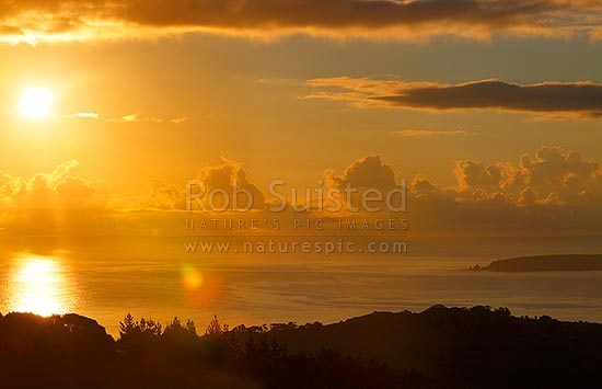Sunrise over Omaha Bay, with Takatu Point and Tawharanui Peninsula at right, Leigh, Rodney District, Auckland Region, New Zealand (NZ) stock photo.