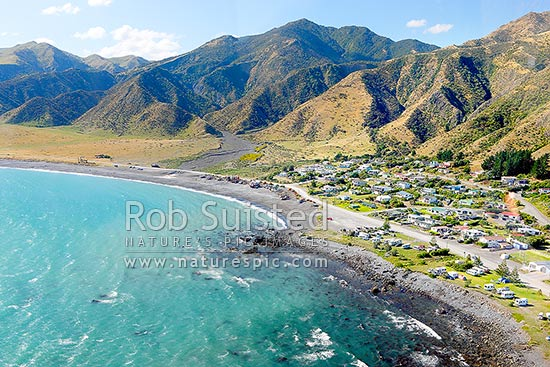 Ngawi village on the Palliser Bay coast near Cape Palliser. Known for the fishing fleet of small boats hauled up on the beach by bulldozers, Ngawi, South Wairarapa District, Wellington Region, New Zealand (NZ) stock photo.