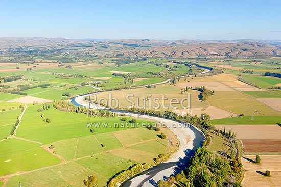 Waiohine River winding east through Wairarapa Plains farmland towards the Ruamahanga River. Aerial photo, Greytown, Carterton District, Wellington Region, New Zealand (NZ) stock photo.