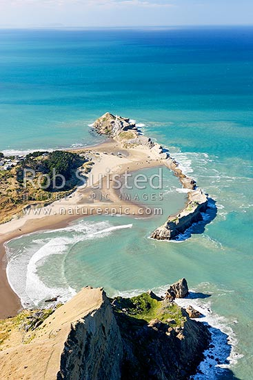Castlepoint lighthouse, reef and lagoon from above Castle Rock (162m). Aerial photo looking north, Castlepoint, Masterton District, Wellington Region, New Zealand (NZ) stock photo.