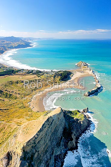 Castlepoint lighthouse, reef and lagoon from above Castle Rock (162m). Aerial photo looking north towards Cape Turnagain, Castlepoint, Masterton District, Wellington Region, New Zealand (NZ) stock photo.
