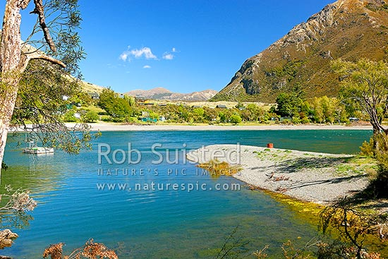 Loch Katrine, with cribs or baches on the South eastern shore, Lake Sumner, Hurunui District, Canterbury Region, New Zealand (NZ) stock photo.