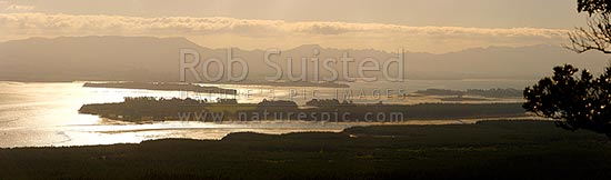 Tauranga Harbour panorama with Matakana Island foreground, Rangiwaea Is. Centre, Motuhoa Is. left, and Kaimai Ranges behind, Mount Maunganui, Tauranga District, Bay of Plenty Region, New Zealand (NZ) stock photo.