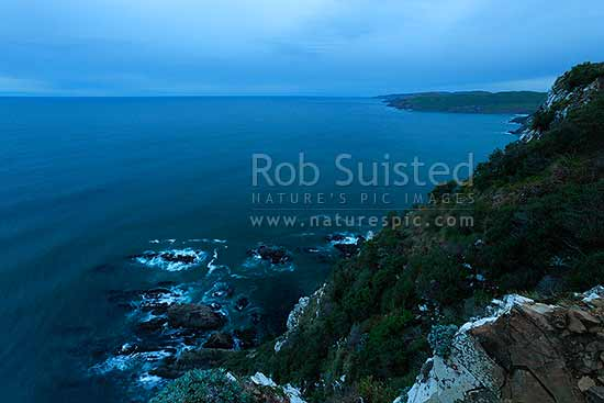 Catlins coastline near Nugget Point, Kaka Point, on a moody evening dusk, looking south, Catlins, Clutha District, Otago Region, New Zealand (NZ) stock photo.
