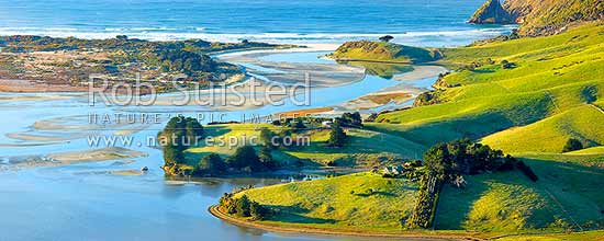 Otago Peninsula farmland, houses and beaches around Hoopers Inlet mouth on a perfect calm later winter morning. Allans Beach left. Panorama, Otago Peninsula, Dunedin City District, Otago Region, New Zealand (NZ) stock photo.