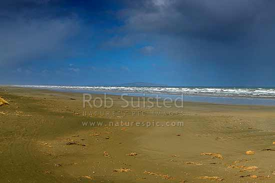 Oreti Beach and sand dunes at Waimatuku Stream mouth, between Invercargill and Riverton. The Bluff hill centre distance, Oreti Beach, Southland District, Southland Region, New Zealand (NZ) stock photo.