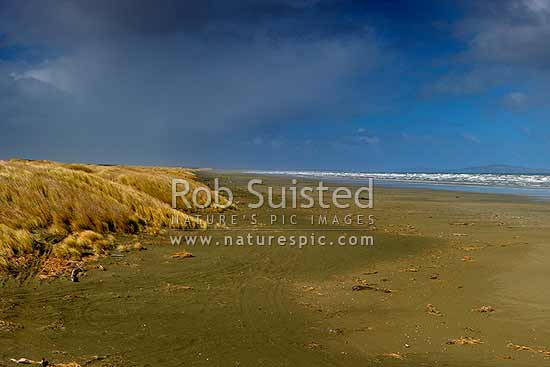 Oreti Beach and sand dunes at Waimatuku Stream mouth, between Invercargill and Riverton. The Bluff hill right distance, Oreti Beach, Southland District, Southland Region, New Zealand (NZ) stock photo.