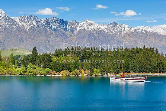 TSS Earnslaw, historic steamship on Lake Wakatipu with The Remarkables Range behind. Working since 1912, Queenstown, Queenstown Lakes District, Otago Region, New Zealand (NZ) stock photo.