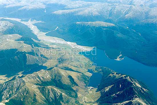 Lake Sumner and Hurunui River. The Nelson Tops and Southern Alps beyond, Lake Mason bottom left, Loch Katrine below right. Aerial view, Lake Sumner Forest Park, Hurunui District, Canterbury Region, New Zealand (NZ) stock photo.