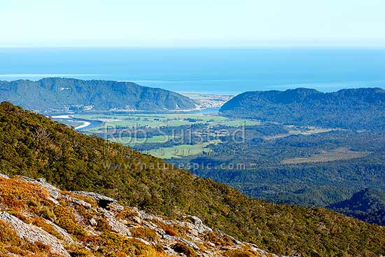 Greymouth town and Grey River (Mawheranui) entering the west coast, from the Paparoa Range. Rapahoe Range at right, Greymouth, Grey District, West Coast Region, New Zealand (NZ) stock photo.