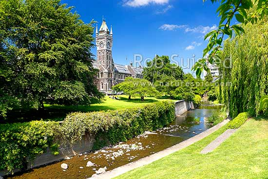 University of Otago Registry Building (Clock tower), built in 1879, seen from across the Water of Leith (River), Dunedin, Dunedin City District, Otago Region, New Zealand (NZ) stock photo.