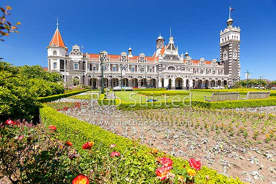 Historic Dunedin Railway Station and gardens, opened in 1906, Dunedin, Dunedin City District, Otago Region, New Zealand (NZ) stock photo.