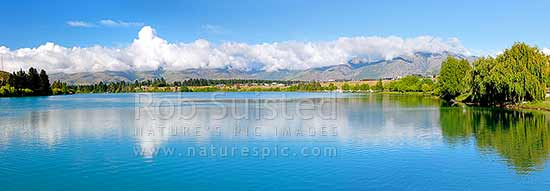 Lake Dunstan, looking up towards the Kawarau River and the Carrick Range. Panorama, Cromwell, Central Otago District, Otago Region, New Zealand (NZ) stock photo.