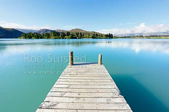 Lake Dunstan jetty at Old Cromwell town. Cornish Point beyond, Cromwell, Central Otago District, Otago Region, New Zealand (NZ) stock photo.