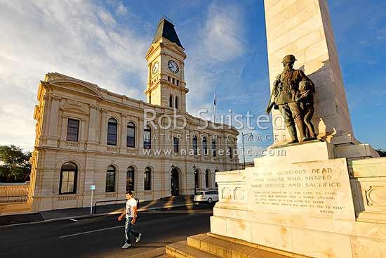 Oamaru's historic whitestone Waitaki District Council building (formerly Post Office 1883) and war memorial, at night, Oamaru, Waitaki District, Canterbury Region, New Zealand (NZ) stock photo.