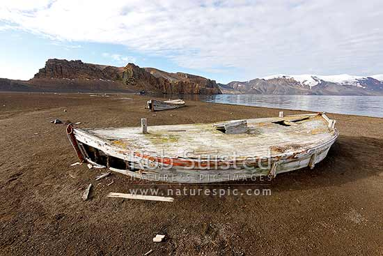Old historic water boats used by whalers to gather freshwater for whaling operations at Whalers Bay. South Shetland islands, Deception Island, Antarctic Peninsula, Antarctica Region, New Zealand (NZ) stock photo.