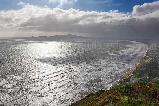 Kapiti coastline on a stormy day. Kapiti Island left, Paraparaumu top right, Paekakariki township right, Paekakariki, Kapiti Coast District, Wellington Region, New Zealand (NZ) stock photo.