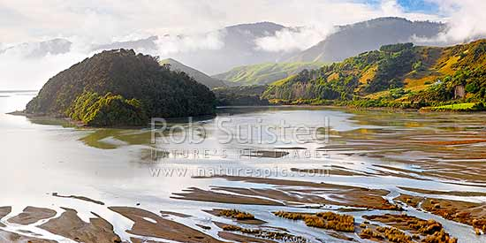 Bishop Peninsula in Delaware Bay Lagoon. Maori Pa Beach isthmus and Delaware Bay far left with coastal hills and distant Bryant Range beyond in mist. Panorama, Cable Bay, Nelson City District, Nelson Region, New Zealand (NZ) stock photo.