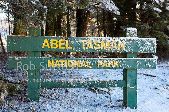 Abel Tasman National Park sign in unseasonal snow, not normally associated with this largely coastal park, Abel Tasman National Park, Tasman District, Tasman Region, New Zealand (NZ) stock photo.