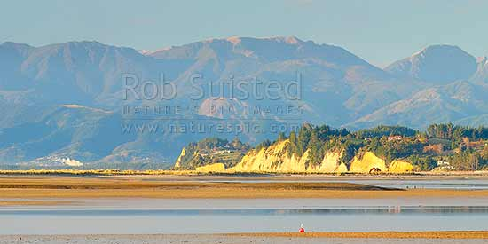 Kina Peninsula and Beach towards Moutere Bluffs and Ruby Bay. Seen across Tasman Bay from Motueka. Mt Rintoul and Richmond Range beyond. Panorama, Motueka, Tasman District, Tasman Region, New Zealand (NZ) stock photo.