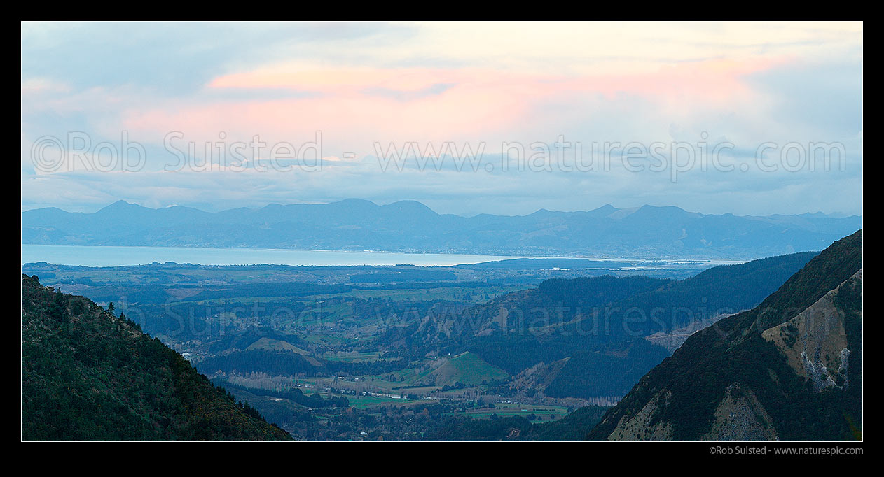 Image of Tasman Bay panorama on a cold winter evening from Kahurangi National Park. Looking over Upper Moutere and Motueka Valley towards Nelson and Richmond Range beyond, Motueka, Tasman District, Tasman Region, New Zealand (NZ) stock photo image