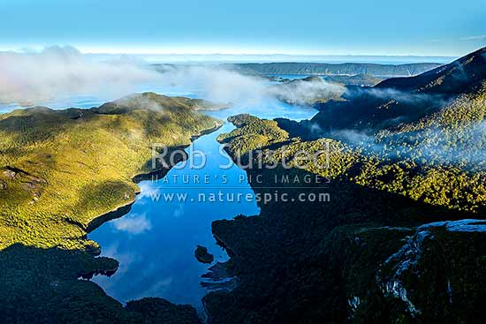 Resolution Island in Dusky Sound, looking over Earshell Cove and The Basin. Five Fingers Peninsula distant, Dusky Sound, Fiordland National Park, Southland District, Southland Region, New Zealand (NZ) stock photo.