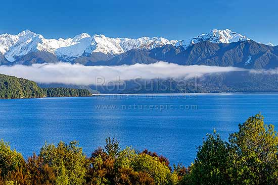 Lake Manapouri and Kepler Mountains and Cathedral Peaks (left). Stony Point centre left and Rona Island centre, Manapouri, Fiordland National Park, Southland District, Southland Region, New Zealand (NZ) stock photo.