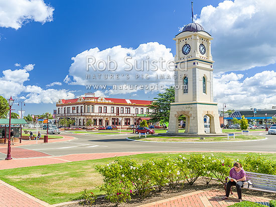 Feilding town, Manchester Square and clock tower. Feilding Hotel Building behind on Kimbolton Road, Feilding, Manawatu District, Manawatu-Wanganui Region, New Zealand (NZ) stock photo.