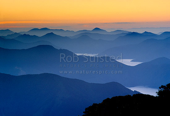 View SW from Mount (Mt) Stokes (1203m) in evening sunset across sounds, Marlborough Sounds, Marlborough District, Marlborough Region, New Zealand (NZ) stock photo.
