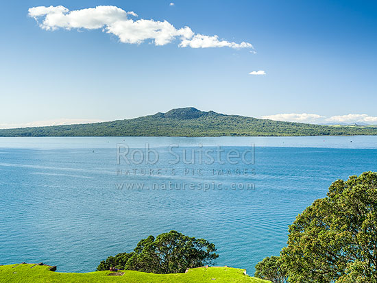 Rangitoto Island in the Hauraki Gulf, seen from North Head. Historic defence gun emplacement bunkers visible at bottom, Cheltenham, Auckland City District, Auckland Region, New Zealand (NZ) stock photo.
