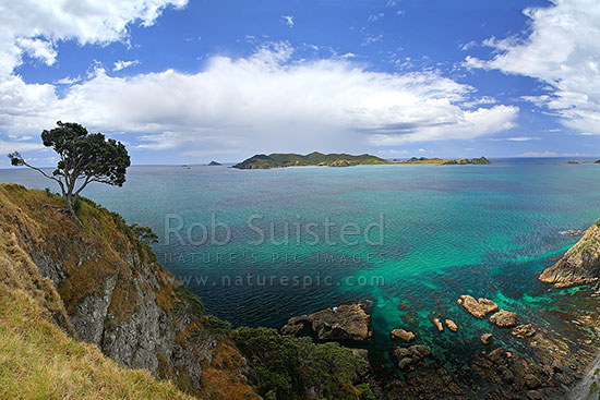 Looking from Matauri Bay headland across Cavalli Passage to the Cavalli Islands -Motukawanui, Motukawaiti, Piraunui, Kohangaro etc, Matauri Bay, Far North District, Northland Region, New Zealand (NZ) stock photo.